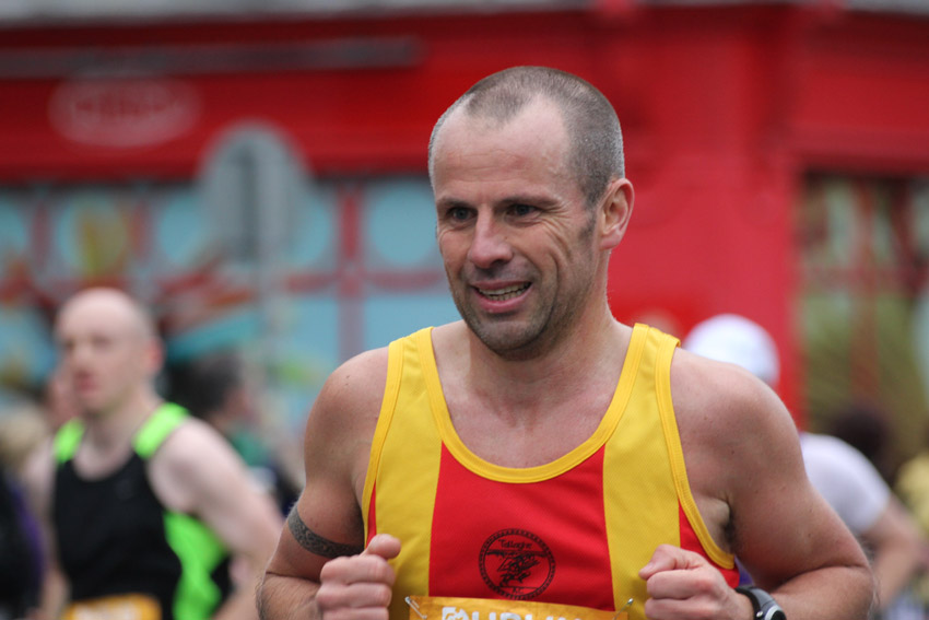 A portrait of a man running in the Dublin marathon