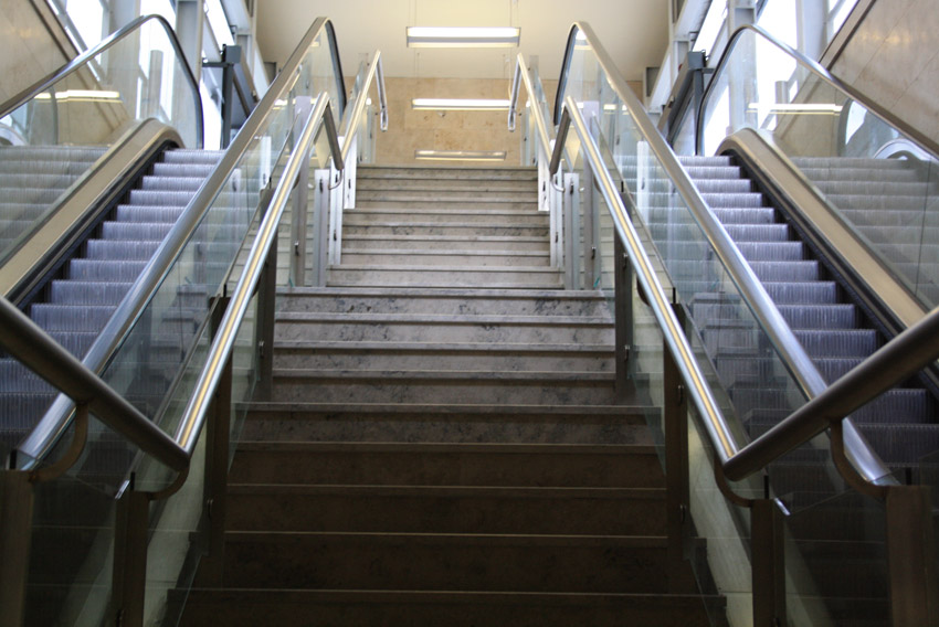 A photograph of a staircase and escalator that is now disused, yet looks in good repair