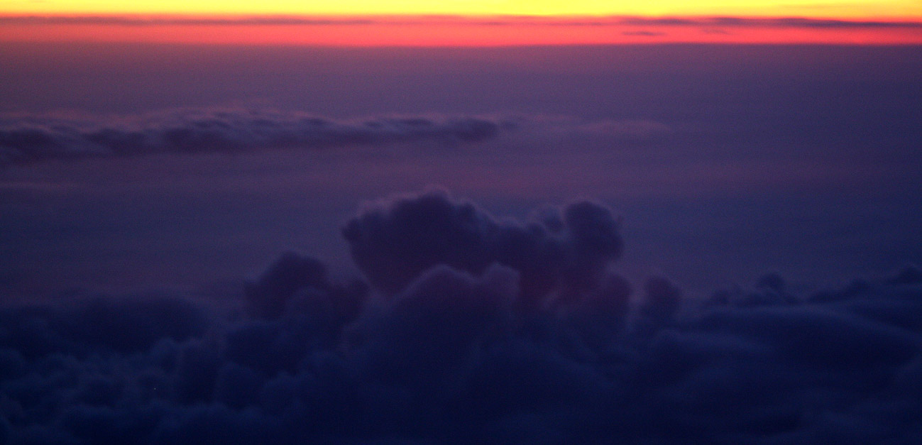 Sunset photograph of clouds from above, taken from an airplane