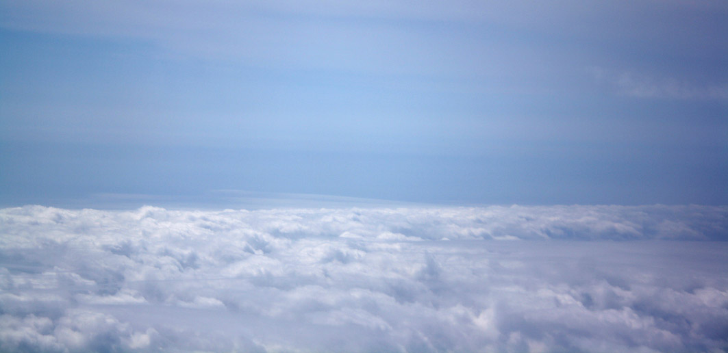 A photograph of clouds from above, taken from an aeroplane window