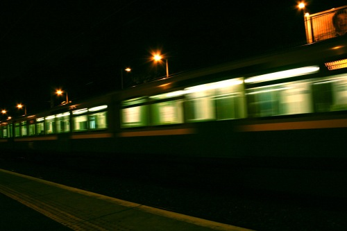 A photograph of a train whizzing past at a station in Dublin