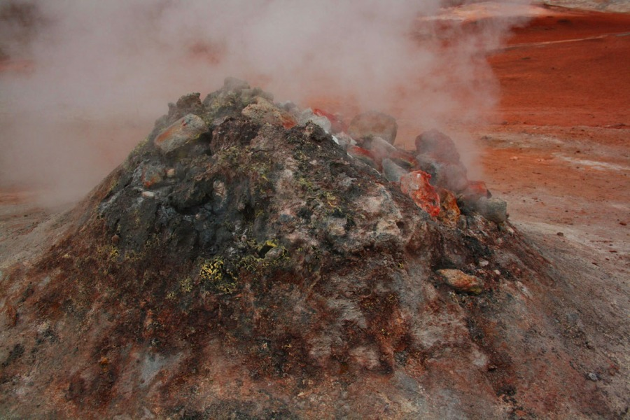 A photograph of a geothermal steam-stack edited to look more volcanic