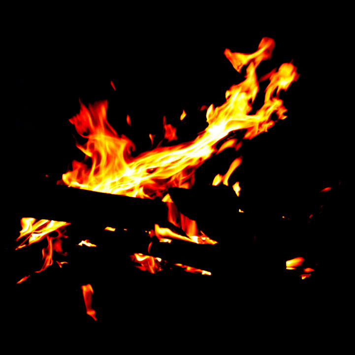 A fire image, dark black background with roaring flames in the foreground