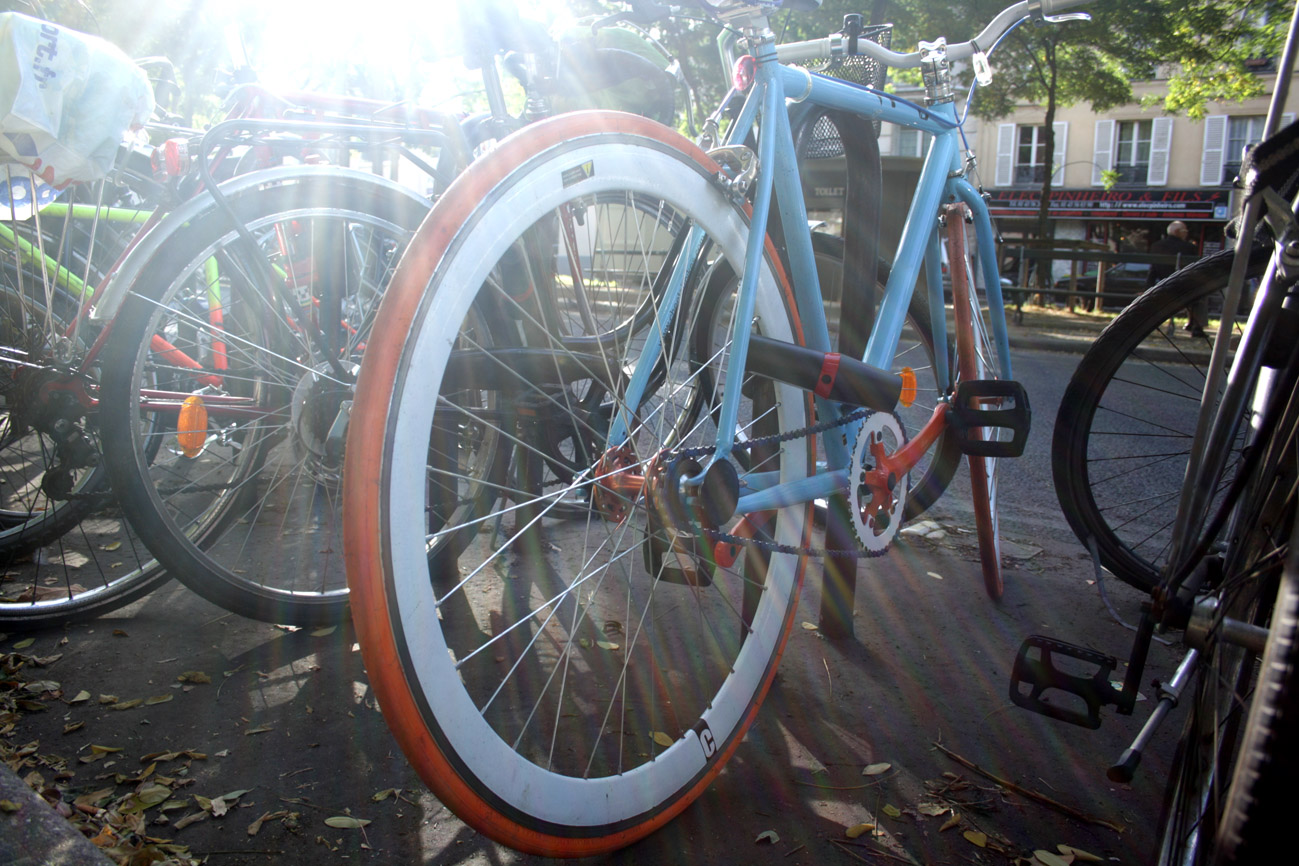 A photograph of a bicycle bathed in bright light