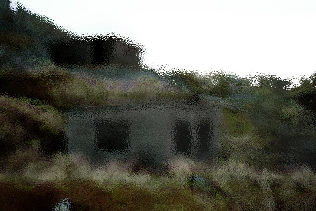 A distorted and blurred photograph of an abandoned building