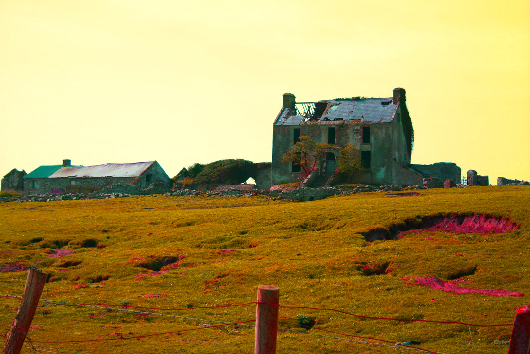 An edited photograph of a country house in Ireland with distorted colours, representing the surreal landscape at the beginning of The Third Policeman